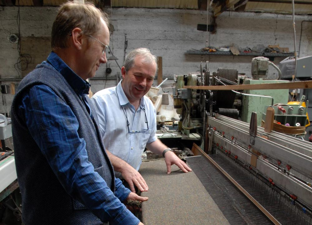 Gerry visiting our good friend & Master Weaver Andrew from the famous Kerry Woollen Mills to go through the weaving process of our stunning tweeds.